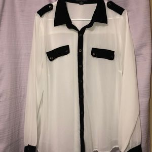 See-through white blouse with black accents